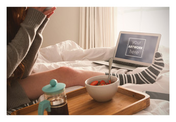Laptop User Having Breakfast in Bed Mockup