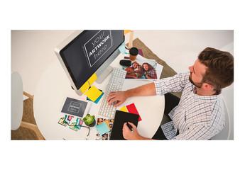 Man Working at Desk with Desktop Computer and Tablet Mockup