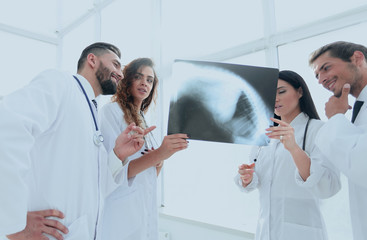 medical workers looking at patient's x-ray film