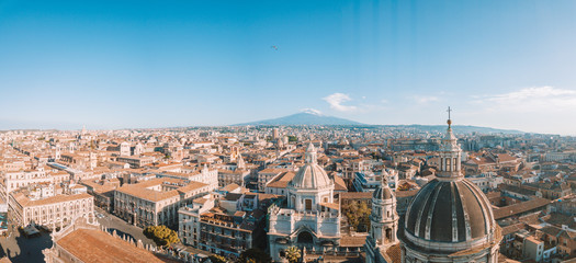 Tuinposter Luchtfoto Aerial view of the Cathedral of Sant'Agata in the middle of Catania with Etna volcano on the background