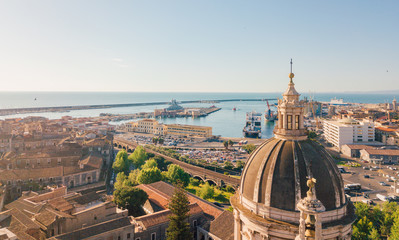 Aerial view of the Cathedral of Sant'Agata in the middle of Catania with Etna volcano on the background Fototapete