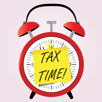 Tax Time concept on small paiper on alarm