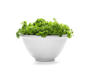 Bowl with fresh green parsley on white background