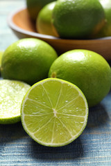 Fresh ripe limes on wooden table. Citrus fruit