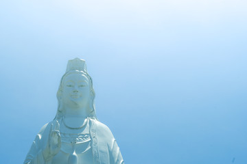 Bodhisattva statue in sky background. Royalty high quality free stock image of white bodhisattva statue in blue sky background. Da Nang city, Vietnam