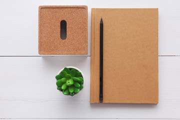 Top view image of open notebook with blank pages on wooden table.