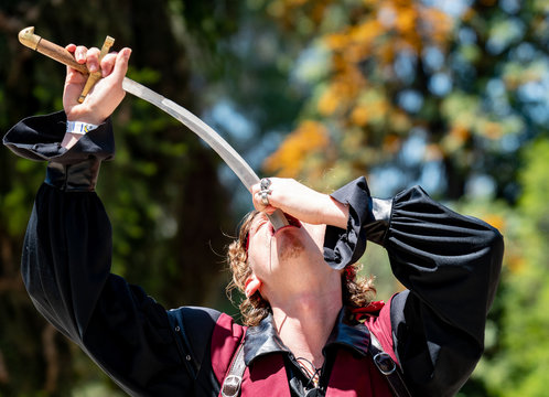 Handsome Sword Swallower Performs Act at Pirate Festival