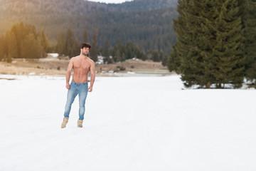 Fototapeta Model Flexing Muscles Outdoors in Nature