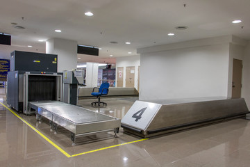 Airport security metal detector scan. Empty scanner control luggage at the terminal. Gate-ray detection with a belt for scanning bags. Check point.