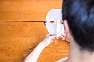 Fototapeta 仮面を持つ男性 obraz
