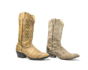 Brown cowboy boots isolated on a white background.