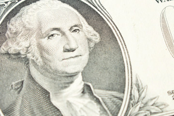 Portrait of President George Washington on 1 dollar bill. Close up