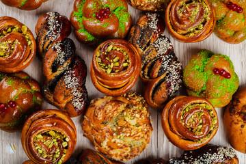 Ruddy fresh beautiful buns on a wooden background.