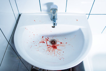 bloody spittle in the washbasin