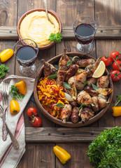 Backed chicken, peperonata and polenta. Rustic style.