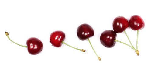 Cherries isolated on white background, top view