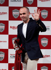 Spain midfielder Andres Iniesta attends a news conference to announce signing for J-League side Vissel Kobe in Tokyo