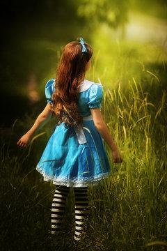 Alice in Wonderland.little girl in costume alice in wonderland