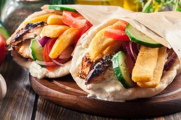 Gyros souvlaki wrapped in a pita bread