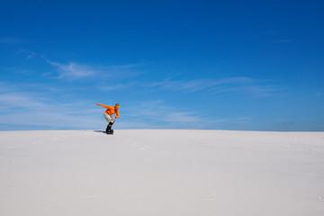 Sand boarding in desert at sunny day