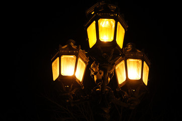 Magical mysterious lantern glows in the dark. Glowing lamp in the night