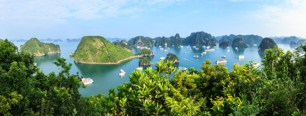 Panorama of Ha Long Bay islands, tourist boat and seascape, Ha Long, Vietnam.