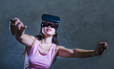 young woman at home sofa couch playing video game using VR virtual reality goggles watching in 3 dimension enjoying curious having fun