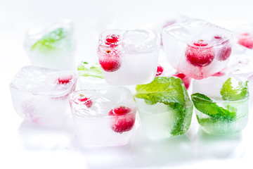 fresh cranberry in ice cubes on white background mock-up