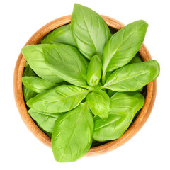 Photo Blinds Condiments Fresh green basil leaves in wooden bowl. Also great basil or Saint-Joseph's-wort. Ocimum basilicum. Culinary herb. Edible, raw and organic. Isolated macro food photo closeup from above over white.