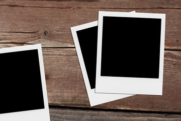 Retro realistic blank instant photo on wooden background.