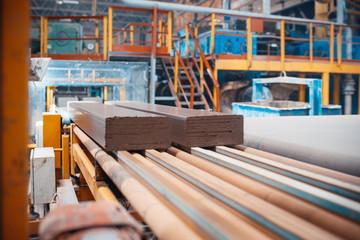 Fototapeta Conveyer Line For Ceramic Tile At Heavy Plant. Factory for the Production of Ceramic Tiles. obraz