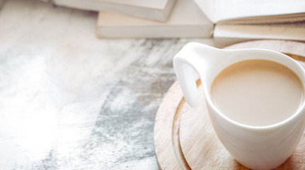 a cup of coffee with books