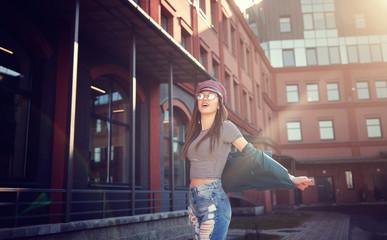 Portrait fashion model girl. Beauty stylish brunette woman posing in fashionable clothes. High fashion urban style