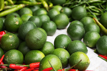Green Lime with different chilli at market
