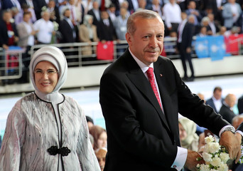 Turkish President Tayyip Erdogan and his wife Emine Erdogan arrive at a meeting in Ankara