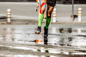 Fotomurales - legs runner man with kinesio tape and compression socks