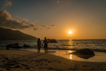 couple on the beach during sunset Tropical island Seychelles