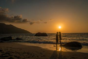 couple on the beach during sunset Tropical island Seychelles