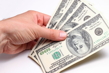 American dollars in hand on a white background