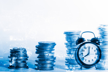 Double exposure rows of coins with clock and city background, Finance and business background concept