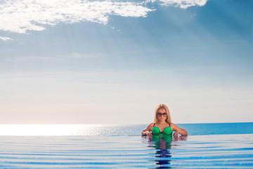 woman on pool in bikini