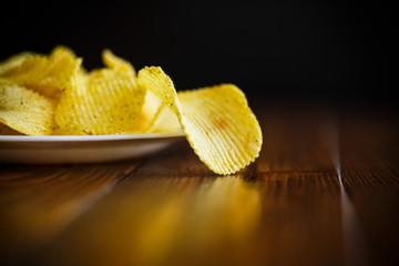 Crispy potato chips in a white plate