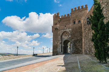 Puerta de Valmardón in the historic city of Toledo with nice sky in Toledo near Madrid, Spain.