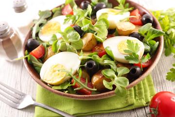 salad with egg, tomato, potato and olive