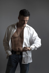 Handsome man in a white shirt posing