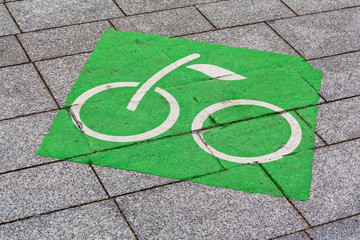 Bicycle lane sign. Green bike symbol means that bike lanes or cycle lanes, bikeways (cycleways) on the roadway are for cyclists only.