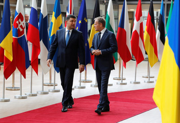 Ukrainian Prime Minister Volodymyr Groysman is welcomed by European Council President Donald Tusk in Brussels