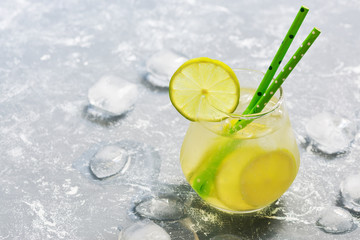 Cocktail drink with lime and ice. A refreshing summer drink. The concept of summer. Place for text.