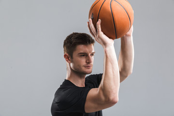 Portrait of a concentrated young sportsman playing
