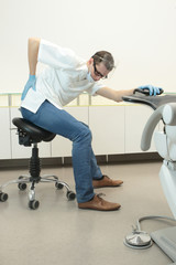 Male dentist exercising in his office waiting for patient